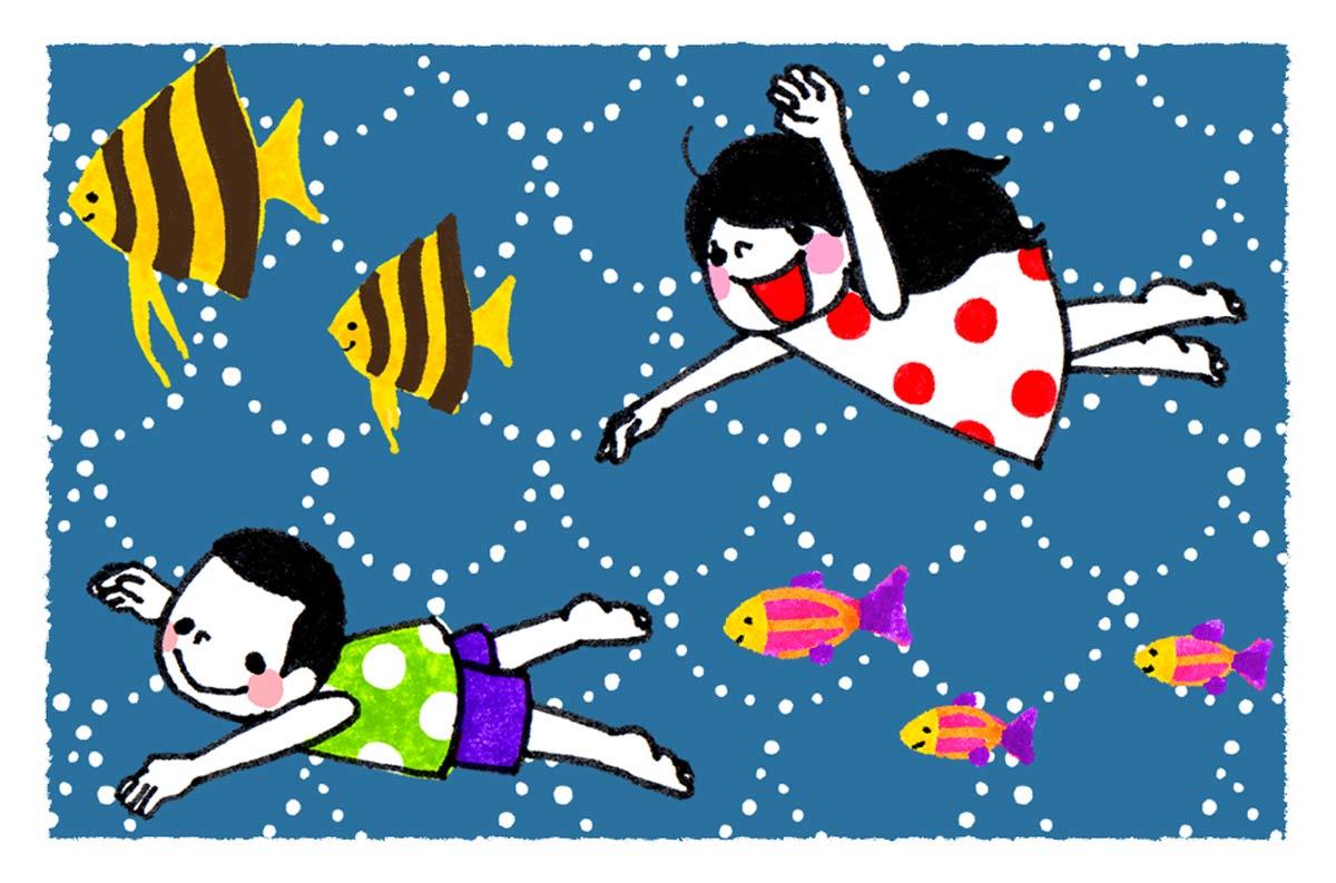 海の中を泳ぐ男の子と女の子