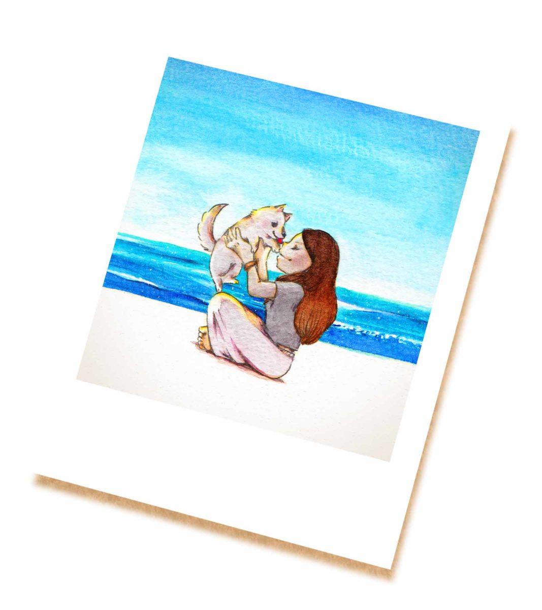 海辺で子犬と戯れる女の子